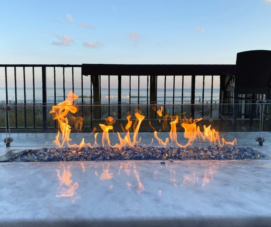 Up close to oceanfront fire pit at Compass Cove